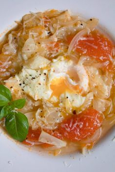 Acquacotta soup with onion, tomatoes, bread and egg.