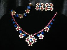 Vintage Flower Power Parure with Sapphire Blue & Fuchsia Rhinestones and White Enameled Gold Tone Metal Flowers.