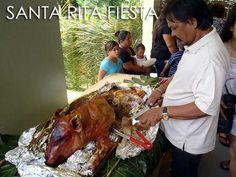 One of my favorites at fiestas ... roast pig!    Guam: Agat Mango Festival, Santa Rita Fiesta & more Guam events   Ivan About Town   Tourist Spots in the Philippines   Philippine Travel Blog