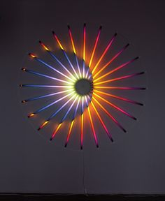 Don't look straight at the sun! Neon art by James Clar.