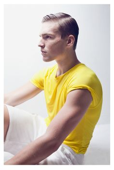 Customized rolled sleeve yellow t-shirt and white shorts.