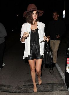 Lucy Hale dines out in West Hollywood in leather shorts and a white button down paired with a brown hat and sandals