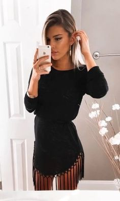 Little black dress with cute fringed hem.