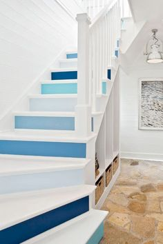 Paint to Create Upbeat Stair Risers Saturated blues, from deep marine to Caribbean turquoise, are interspersed with cool gray and set off by lots of clean white, giving these stairs a sophisticated edge. Painted Staircases, Painted Stairs, Spiral Staircases, Basement Stairs, House Stairs, Basement Bathroom, Deck Stairs, Concrete Stairs, Stair Lighting