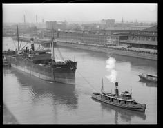SS Evelyn being towed through the Fort Point Channel along South Station