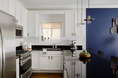 """In <a href=""""https://www.homepolish.com/mag/a-chicago-writers-jeweled-home"""" target=""""_blank"""">Aubre's Chicago home</a>, Homepolish designer Megan Born completely renovated the kitchen, painting the cabinets with a fresh coat of white and introducing white subway tile with black grout. The only thing that stayed were those black granite countertops."""