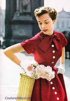 """""""One red dress, perfect for a day of shopping on 5th Avenue or the Champs Elysees. Cotton pique is set off with a long row of buttons down the front and a bow at the neckline. The huge full skirt has deep unpressed pleats and pockets at the hips. By J.L.F Originals."""" 1949. via Couture Allure Vintage Fashion Blog."""