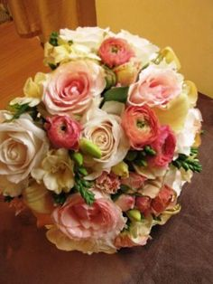 $225 Spring time #wedding #bouquet by @nancyliuchin. Featuring ranunculus, freesia, mini callas and roses.