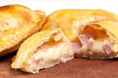 Ham and Cheese Empanadas: a pastry turnover filled with various savory fillings and baked or fried. In this case, were smothering leftover sweet baked ham with shredded cheddar cheese to make these wonderful, easily handheld lunchtime treats. Mexican Food Recipes, Gourmet Recipes, Cooking Recipes, Meat Recipes, Latin Food, Homemade Ham, Leftover Ham Recipes, Leftovers Recipes, Dinner Recipes