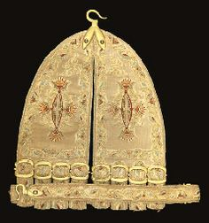 AN EMBROIDERED RAPIER-CARRIER IN LATE 16TH CENTURY STYLE Of leather faced with silk, embroidered with bands of gilt-wire scrolling flowers all picked-out in polychrome silks, and with gilt metal hooks and buckles (the ground fabric worn). 11½in (29.3cm)