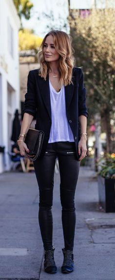 Anine Bing is wearing a black blazer, bodysuit, leather trouser and bag. All from Anine Bing