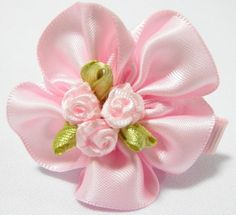 Triple Rose Baby Hair Clip Pink. 4cm (L) by 4cm (W). Ideal for children from 1 1/2 year old onwards. 1 for $1.50. Like us at https://www.facebook.com/pages/ChucklingBaby/675475065907287.