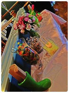 Candy bar. Papers bags in miniature wellies. Flowers. Garden theme. Birthday.