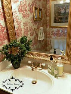 Love the red toile walls in the bathroom!!