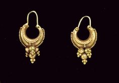 A PAIR OF ROMAN OR PARTHIAN GOLD EARRINGS  CIRCA 2ND CENTURY A.D.  Each boat-shaped, tapering at the ends to wires that form the closure, ornamented with rows of granules outlining the hoop, with a rigid pendant below composed of a cluster of four hollow spheres, each terminating in a pyramid of granules