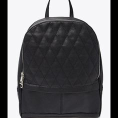 """Black Backpack A faux leather backpack with a quilted front and concealed exterior zip pocket, three interior pockets, and a top handle. Zipper closure, adjustable shoulder strap Fully lined Shell: 100% polyurethane; Lining: 100% polyester Made in China SIZE DETAILS: 13"""" height x 11"""" width x 4.5"""" depth Forever 21 Bags Backpacks"""