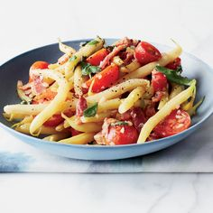 Ready in just 30 minutes, Jody Williams's warm wax bean salad gets a burst of flavor from sweet cherry tomatoes and salty bacon.