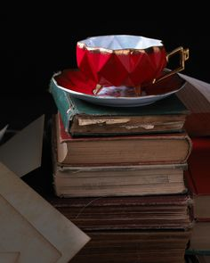 Photography ©William Brinson <---Photography as Art, feels like a painting, love the rich red and the juxtaposition against the ragged book stack #bywstudent