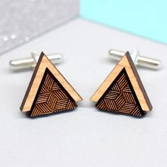 A pair of gorgeous wooden triangle cufflinks decorated with a modern, geometric pattern. These wooden cufflinks are carefully handmade in our Brighton studio. The wooden triangle design is laser cut from reclaimed British cherry wood, with the geo...