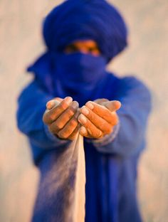 ".these men in the desert are called ""men in blue"" they travel days without water or anything"