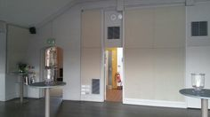 Balcony room - entrance and kitchen wall
