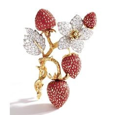Gold, diamond and coral strawberry brooch. photo Sotheby's    The brooch set with round diamonds weighing approximately 4.75 carats, mounted in yellow and white gold;