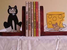 A personal favorite from my Etsy shop https://www.etsy.com/listing/290426943/handmade-wooden-bookend-that-shows-a-cat
