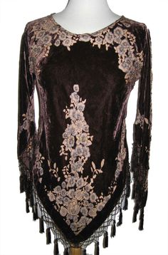 Exquisite top in a deep brown to wear with your Western Skirts or Gauchos, for a Formal Western Wear or just to wear with your jeans. The top has a beautiful design and is cut on the bias. The sleeves come to a point and beaded fringe adorns this top all around the hem and the sleeves. The round scoop need is very flattering. Mixture of Rayon and Sild. Dry Clean. Made in USAOne Sise fits up to size 16.