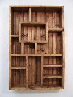 Wooden Display Bookshelves | I love the various shapes used to display. It makes for an interesting bookcase design.
