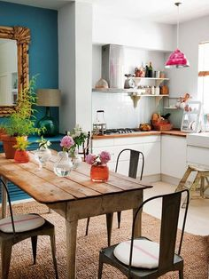 I love everything about this kitchen - small, white and turquoise, wooden counter top, rustic table...