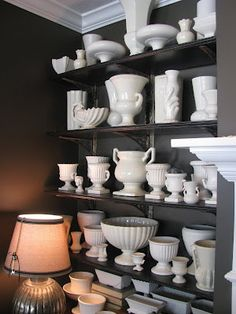 Love the white vase collection against the dark wall. I WANT A VINTAGE VA Vintage Vases, Vintage Pottery, Vintage Planters, Vintage Shelving, Mccoy Pottery, Display Shelves, Book Shelves, White Vases, Displaying Collections