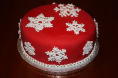 - Made for a Christmas party at school. Red velvet cake with cream cheese filling, then covered in fondant. Royal icing snowflakes dusted with sugar and dragees.
