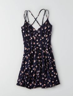 Take your look from day to night. This dress features pretty, strappy details and a free-spirited print.