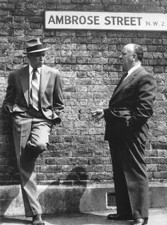 """Jimmy Stewart and Alfred Hitchcock during the filming of """"The Man Who Knew Too Much"""" (1956)"""