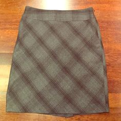 Limited size 10 skirt Perfect condition size 10 skirt from Limited. Worn a few times. Material is very soft and there is a gray lining. Slit in back of skirt. The Limited Skirts