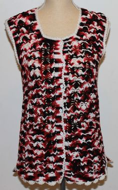 a5bc804ac255 Hand made, pink, black and white crochet sleeveless cardigan with hip  pockets.