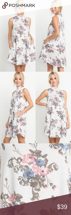 🆕 Off White Floral Mock Neck Sleeveless Dress Off White with floral print. Mock neck swing dress with pockets. Perfect for spring! 65% polyester 35% rayon Save by bundling Dresses