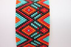 Tuquoise and Burnt Orange-Hand Beaded Peyote Cuff by Seasidelily