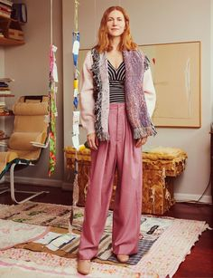 Susan Cianciolo, at home in Fort Greene, Brooklyn. Cianciolo wears Bless cardigan and pants; Susan Cianciolo bodysuit; Maryam Nassir Zadeh boots.