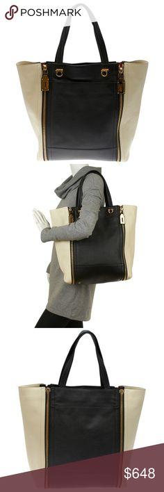 "Salvatore Ferragamo Suzanne (118489) This Salvatore Ferragamo Suzanne tote bag features creasing to the exterior & light interior wear. •Exterior Condition: Like New •Interior Condition: Like New •Material: Leather •Origin: Italy •Interior Lining: Fabric •Hardware: Gold-Tone •Meas (L x W x H): 15x5x15 •Handle Drop: 8"" •Exterior Pockets: 0 •Interior Pockets: 3 •Odor: None •Age Group: Adult •Weight: 2 lb •Production Code: EE-21 E084 Salvatore Ferragamo Bags Totes"