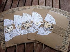 These wedding invitations are completely customizable. They each feature a paper doily, layered with a burlap strip, unique vintage letter paper and topped with a fully customizable wooden heart. They are stitched together using kraft paper and lovely, high quality vellum paper. The color and type of stitching is also customizable. I paired them with a vintage newspaper bag to serve as the envelope and give it a polished vintage finish. (Sold separately).