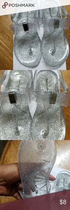 Silver glitter sandals Worn twice by my daughter. It's very pretty and good condition. Selling it as its winter and boot time now.  She will outgrow it by spring. It doesnt have a size tag on it. But it fits her and she is US shoe size 10-10 1/2. Shoes Sandals & Flip Flops