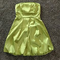 Green cocktail dress Lime green satin cocktail dress. Super cute for a semi formal event. Only worn twice. Once to a homecoming and second to a fundraiser Dresses Mini
