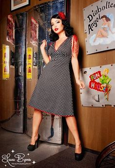 Anna Dress in Black Polka Dot with Red Trim - If you're looking for the perfect casual-yet-cute summer dress, look no further!  Made from a soft, stretchy poly/spandex blend, The Anna Dress by Pinup Couture is as comfortable as it is cute! Features include: a soft, feminine aline shape, gathered shoulders with ties for adjustability, a deep-v gathered bodice that compliments any bust size, and cute contrast trim along the neckline and hem.