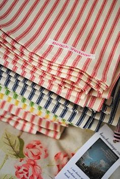 Stack of colorful ticking fabrics