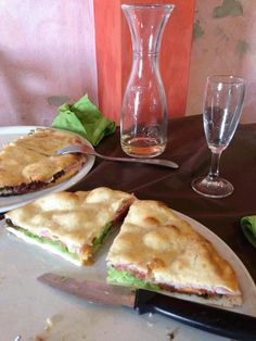A cross between a thin focaccia and a pizza base, split and filled with proscuitto and salad at Ristorante Pizzeria Bellaria, Italy. Buonissimo!
