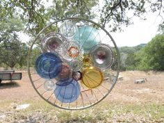 Giant sun catcher...I added thrift store dishes to an old bike rim (judy e)