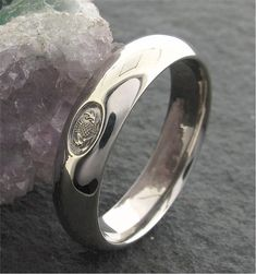 Handmade Scottish Thistle wedding ring in platinum. An original design It is 6mm wide and made from a heavy court band.  The court style is more comfortable to wear as it is curved on the inside as well as the outside. Perfect for your special day.  This Scottish Thistle ring is