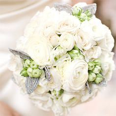 White roses, ranuncluses and beaded leaves -White Wedding Flowers | Brides.com