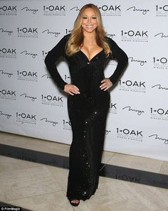 Hearttaker: Mariah Carey once again wore the half-million dollar yellow diamond heart pendant gifted to her by her billionaire boyfriend James Packer on Saturday night